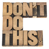 Do not do this warning. Isolated text in vintage letterpress wood type printing blocks Royalty Free Stock Image