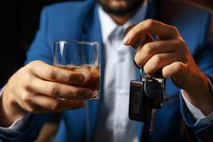 Do not drink and drive Cropped image of drunk man talking car. Keys stock photography