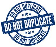 Do not duplicate stamp. Do not duplicate round grunge stamp isolated on white background Royalty Free Stock Photos