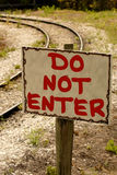 Do NOT ENTER sign. Near a rail road track Royalty Free Stock Photo
