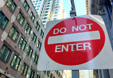 Do not enter sign against tall buildings Stock Photo