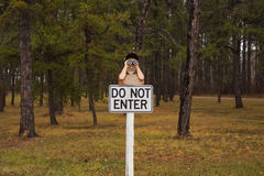 A  Do Not Enter  sign with a guy with binoculars carved on top Royalty Free Stock Photos