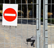 Do not enter sign on a metal fence. Next to a construction site royalty free stock photo