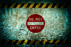Do not enter warning sign on dirty wall background with grunge a Stock Image