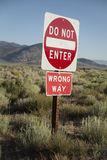 `Do Not Enter` `Wrong Way` Road Sign. A sign on an American highway saying `Do Not Enter` and  `Wrong Way Royalty Free Stock Images