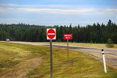 A Do Not Enter and Wrong Way sign on a highway Royalty Free Stock Photos