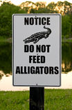 Do Not Feed Alligators Sign. Sign warning not to feed alligators (it is actually illegal Royalty Free Stock Photography