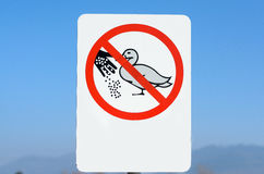 Do not feed ducks sign close up Royalty Free Stock Photo