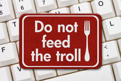 Do not feed the troll sign on a keyboard Royalty Free Stock Photography