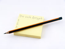 Do not Forget!. Notes and pencil isolated over white background Stock Photography