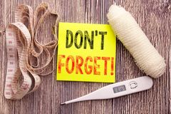 Do Not Forget. Business fitness health concept for Reminder Message written sticky note empty paper background with copy space ban Stock Photography