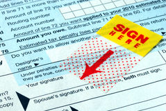 Do not forget to sign the tax return Royalty Free Stock Photography