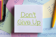 Do Not Give Up written on a note Stock Photos
