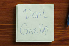Do Not Give Up written on a note Stock Image