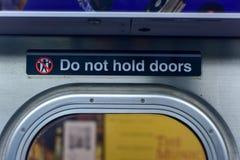 Do not hold doors - NYC Subway Royalty Free Stock Photos