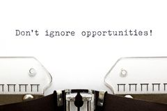 Do Not Ignore Opportunities Typewriter. Don`t Ignore Opportunities printed on an old typewriter Stock Photo