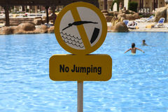 Do not jump in the pool plate Stock Image