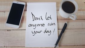 Do not Let Anyone Ruin Your Day. Don`t let anyone ruin your day. Motivational inspirational quotes words. Wooden background stock images