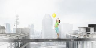 Do not let your child walking around. Mixed media. Concept of child in danger walking on balk. Mixed media Stock Image