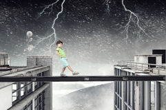 Do not let your child walking around. Mixed media. Concept of child in danger walking on balk. Mixed media Royalty Free Stock Photo