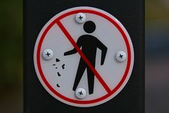 Do not litter sign. In white background and red circle royalty free stock photography