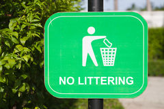 Do not litter Signs. On garden Stock Photos