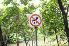 Do not litter signs in park. Background royalty free stock photo