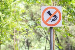 Do not litter signs in park. Background royalty free stock images