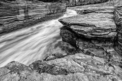 Do Not Lose Your Footing Here !. Long exposure shot new a rapid flowing river Stock Photos