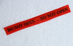 Do-not-open sign in red on a white background Stock Photography