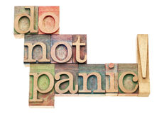Do not panic. Warning - isolated text in vintage letterpress wood type printing blocks Royalty Free Stock Image