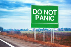 Do not panic road sign by the freeway Stock Images