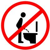 Do not pee stand on to the closet toilet red circle prohibition warning sign.  Stock Photos