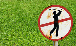 Do not play golf signs with green grass Stock Photo