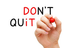 Do Not Quit Do It Concept. Hand writing Do Not Quit, Do It concept with marker on transparent glass board stock image