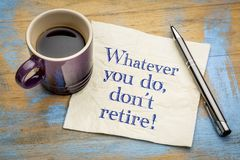 Do not retire advice on napkin. Whatever you do, don`t retire - handwriting on a napkin with a cup of espresso coffee Royalty Free Stock Photos