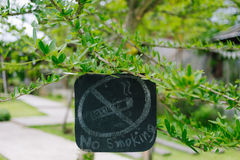 Do not smoke sign in the garden Stock Images