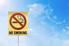 Do not Smoking gold sign on the sky. Royalty Free Stock Photography