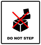 DO NOT STEP packaging symbol on a corrugated cardboard background. For use on cardboard boxes, packages and parcels Stock Photos
