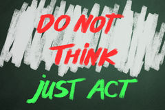 Do not think just act words on chalkboard. Backgruond royalty free stock photo