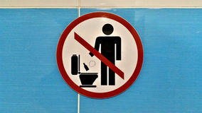 Do not throw trash in toilet Royalty Free Stock Image