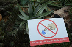 Do not touch the butterflies sign. Stock Images