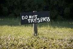 Do not Trespass!. A hand painted sign with a strong message. Concept for poor security in IT or other area. Clipping path included for the sign and the post down stock images