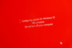 Do not turn off your computer during configuring Windows 10 Upgr. PARIS, FRANCE - JAN 7, 2016: Configuring update for microsoft Windows 10 operating system OS Stock Photos