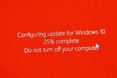 Do not turn off your computer during configuring Windows 10 Upgr. PARIS, FRANCE - JAN 7, 2016: Configuring update for microsoft Windows 10 operating system OS Stock Photo
