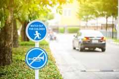 Do not use vehicles horn sign stick on tree. Silence zoning.Watch out for children road sign.Please Drive Slow. Do not use vehicles horn sign stick on tree royalty free stock images