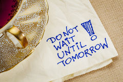 Do not wait until tomorrow. Motivational reminder - a napkin doodle with a cup of tea Royalty Free Stock Photo