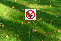 Do not walk on the grass Royalty Free Stock Image