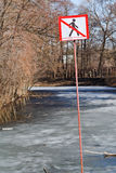 Do not walk sign on frozen river in spring Royalty Free Stock Photo