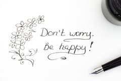 Do not worry. Be happy! with fountain pen and ink Stock Photography